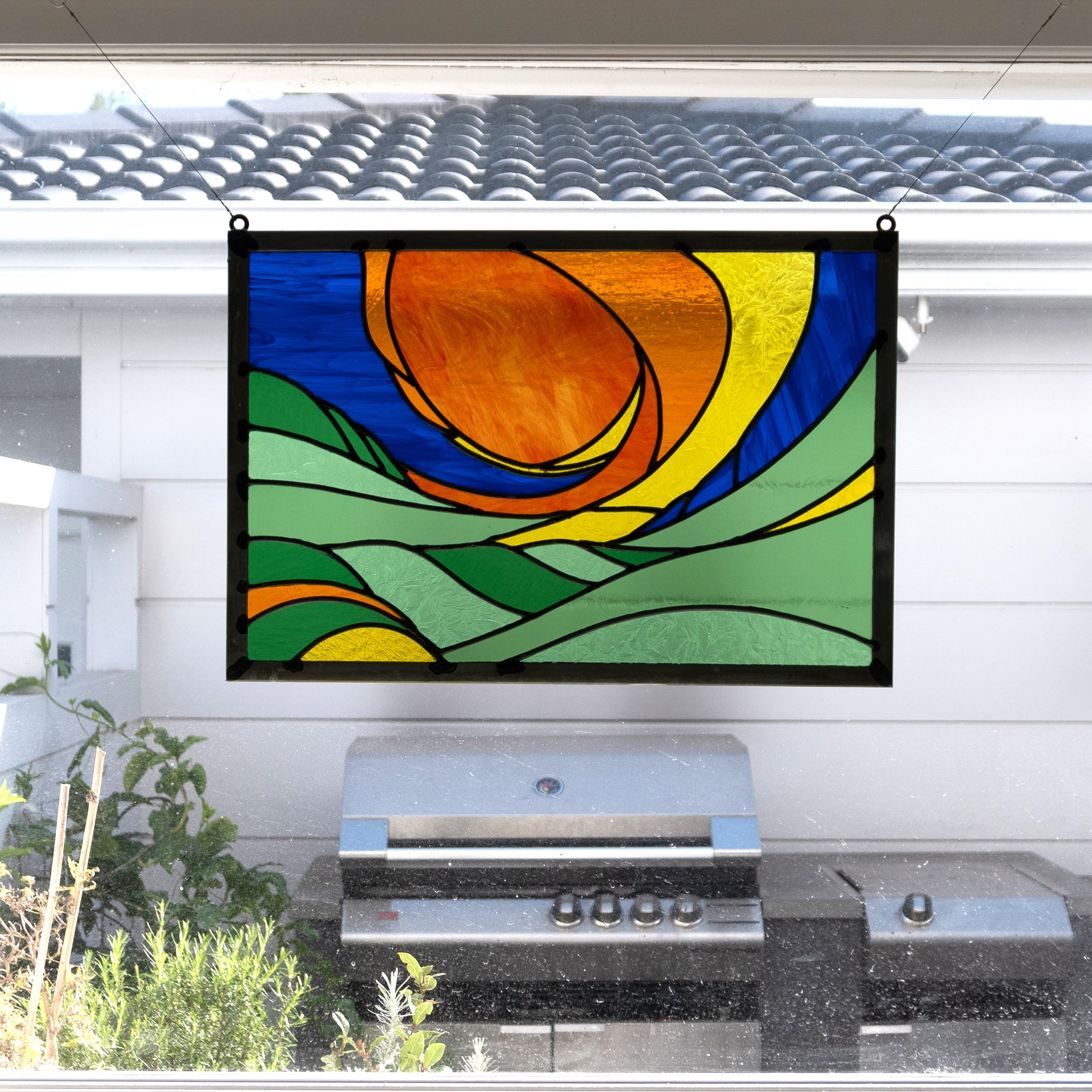 Raising sun, stained glass panel installed