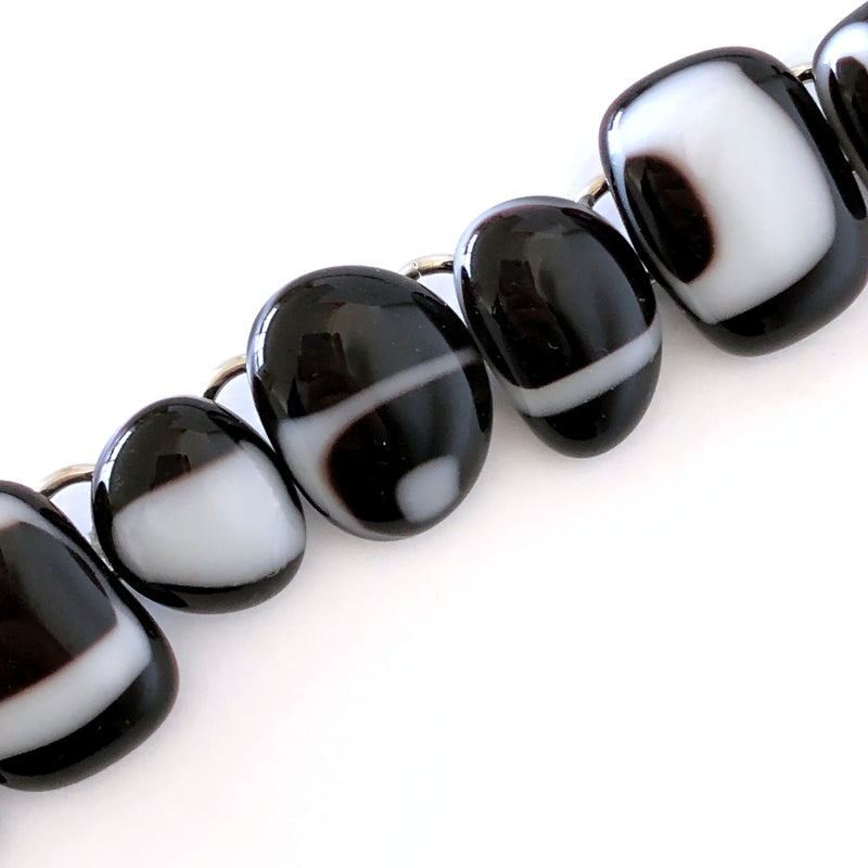 Accessorise business casual to everyday wear with this black and white link bracelet