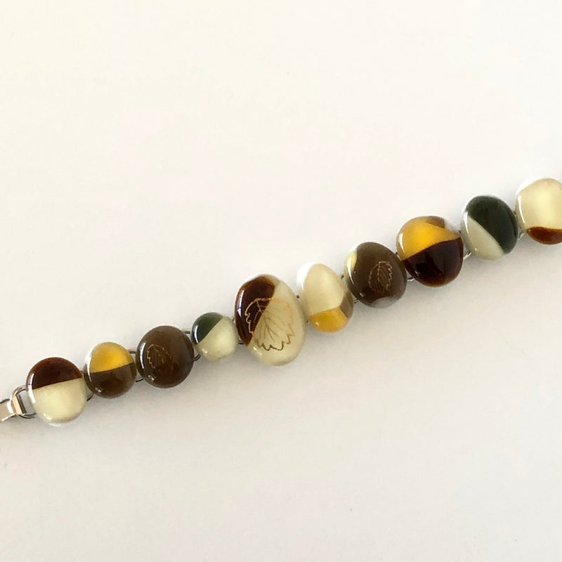 one-of-a-kind glass bracelet with gold decal
