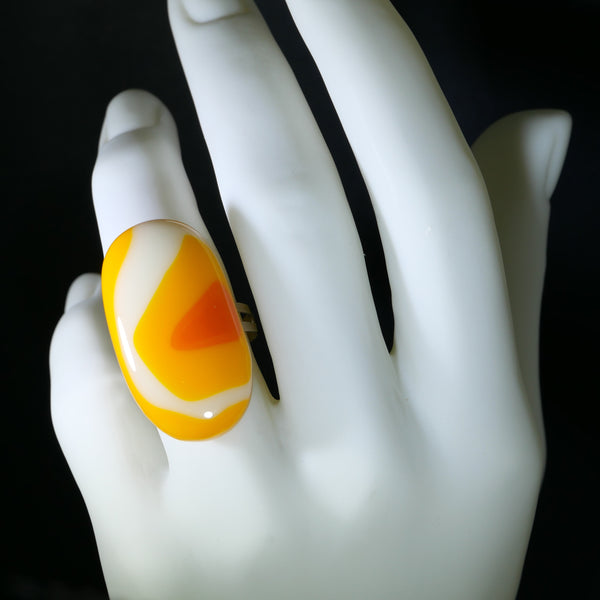 large oval statement ring in orange and yellow