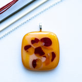 bold bright yellow and red fused glass pendant