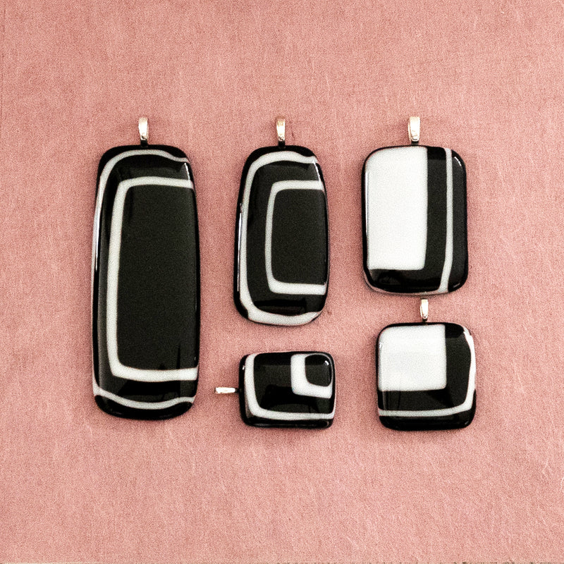 selection of black & white statement pendants in  different sizes