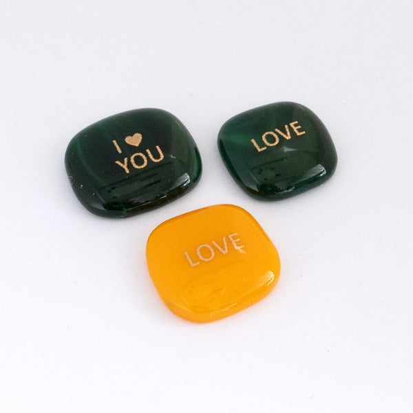 "Glass stone with golden ""Love"" decal"