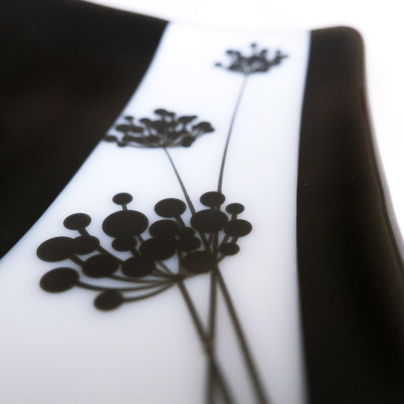detail of floral accent, black and white sushi plate