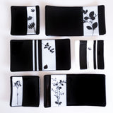 black and white decorative plates with floral accents