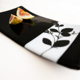 Handmade glass plate, fused black and white opaque glass.