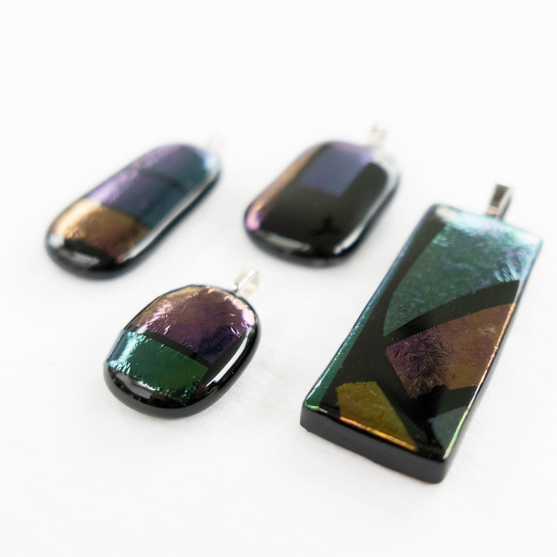Fused glass pendant, black and iridescent glass