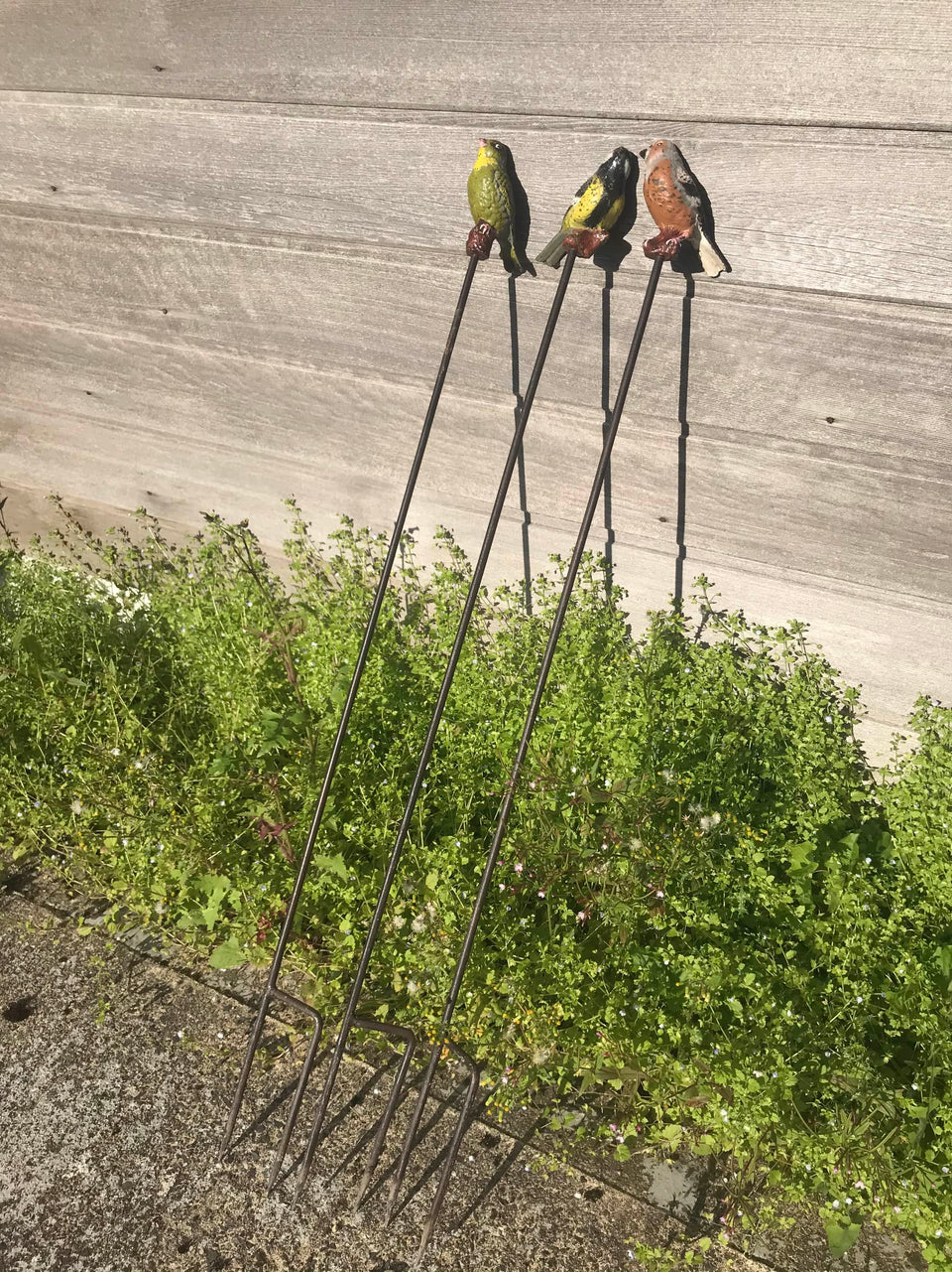Three Cast-Iron-Birds on Iron Spikes