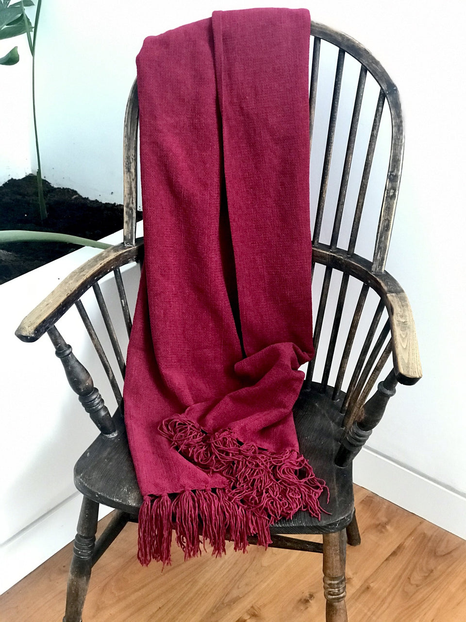 soft red throw with tassels