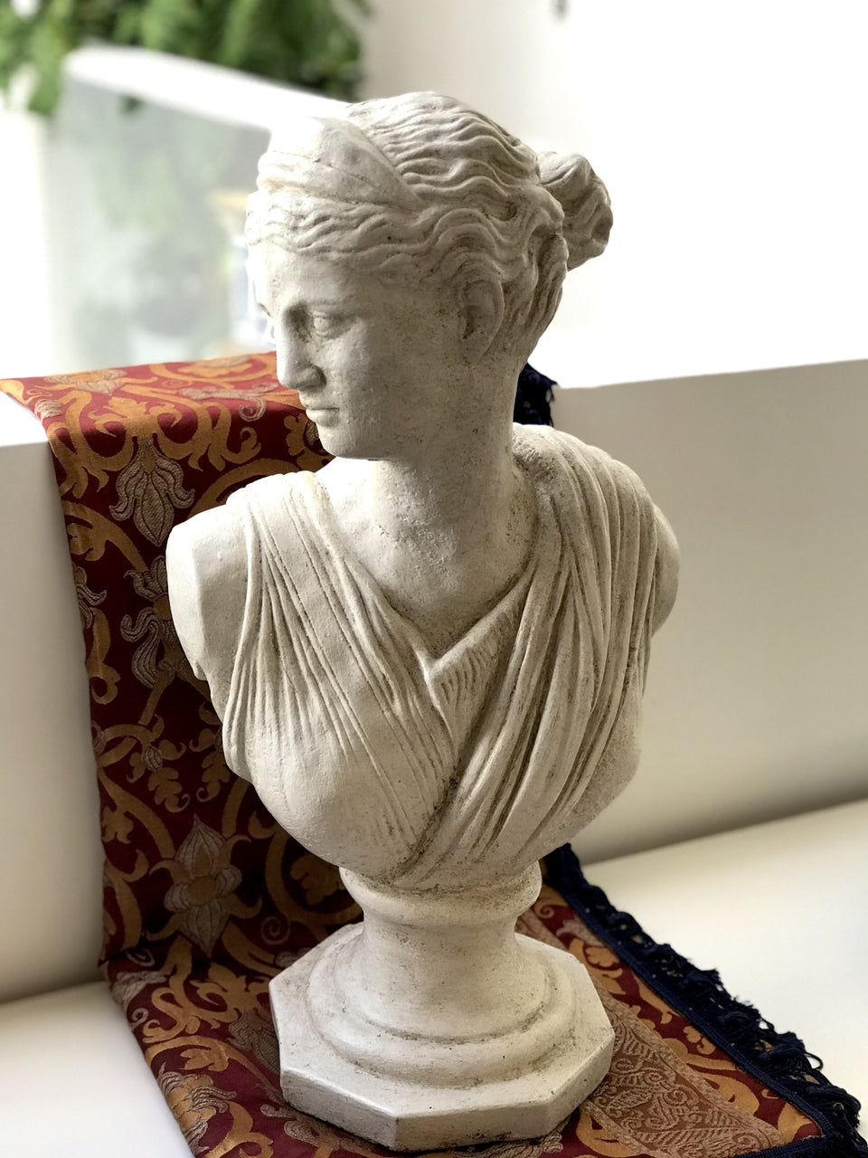 Classical bust of a young woman