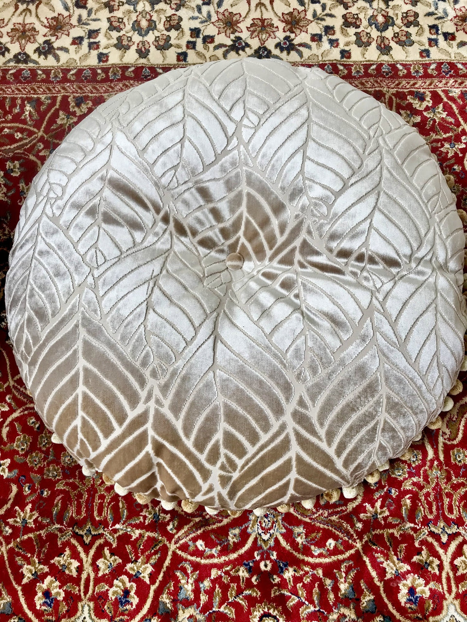 round buttoned damask cushion