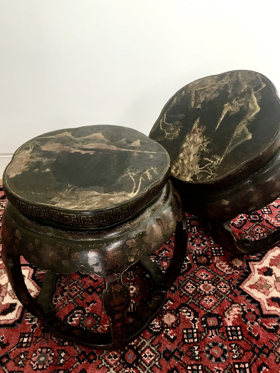 A pair of antique Chinese lacquered stools