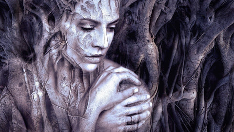 A fantasy image in black and white of a woman born from trees.