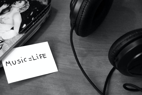 https://www.pexels.com/photo/grayscale-photo-of-printer-paper-with-printed-music-life-near-headphones-3104/