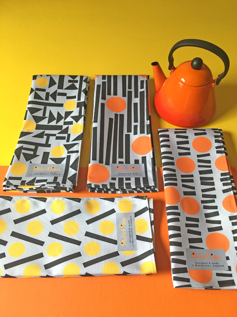 Yellow and orange teatowels