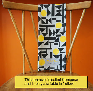 yellow, black and grey teatowel