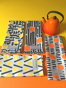 Orange and yellow teatowels