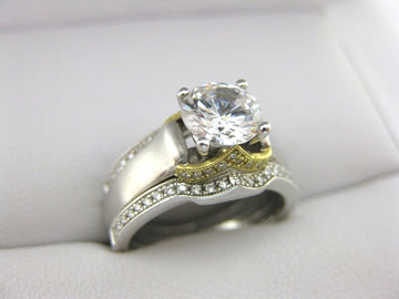A1950 - 18 Karat White Gold Simon G. Engagement Ring and Bands