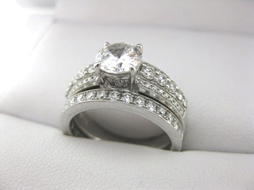 A1953 - 18 Karat White Gold Simon G. Engagement Ring and Band