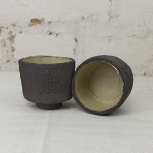 Small tea cups, black clay, hand build