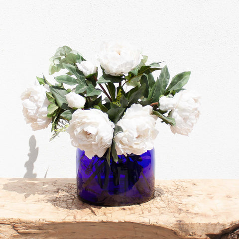 Blue glass vase with flowers