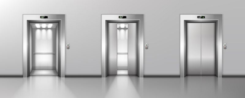 Open and closed elevator doors in office  #504