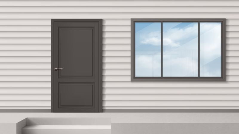 House facade with gray door, window, siding  #279
