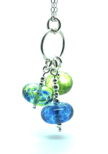 Cluster of three happy glass beads in shades of green and blue