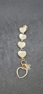 Gold and fuzzy heart chain charm