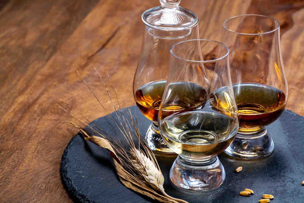 What main ingredients is bourbon or scotch made from?