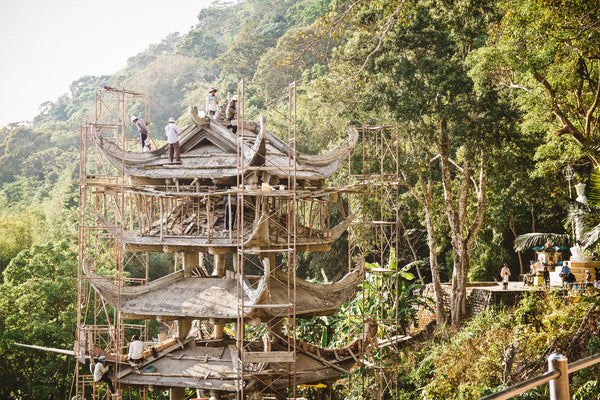 Men restoring old building high up in the mountains
