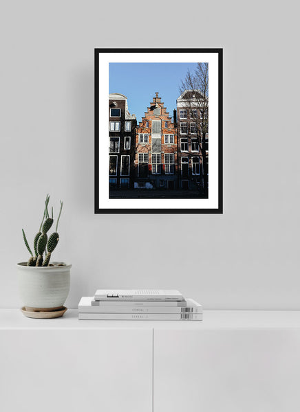Orange canal house in Amsterdam