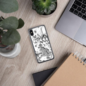 A portion of a black and white map design by Deven Rue on the back of an iPhone X/XS case. Succulents and office supplies are in the background.