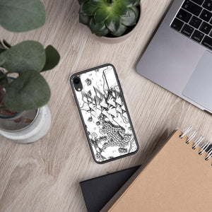 A portion of a black and white map design by Deven Rue on the back of an iPhone XR case. Succulents and office supplies are in the background.
