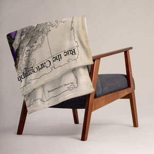 Rue the Cartographer throw blanket by Deven Rue draped over a chair.