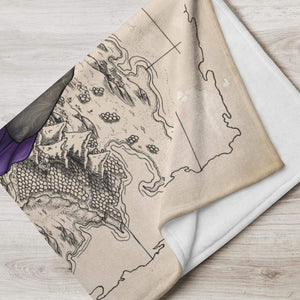 Rue the Cartographer throw blanket by Deven Rue folded into a neat rectangle.