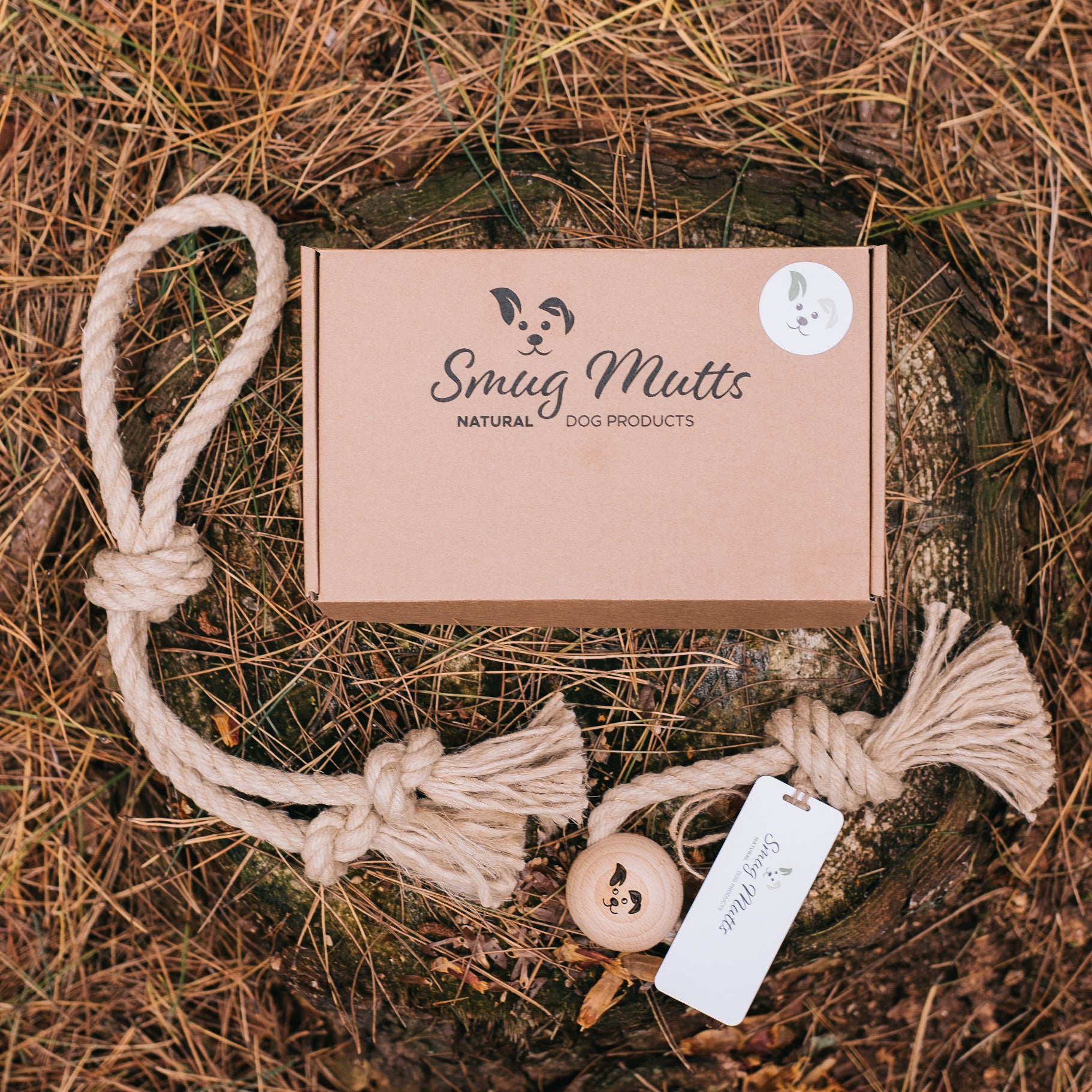Smug Mutts Natural Hemp and Beech Wood Rope Toys and Packaging in Woodland Flat Lay Scene