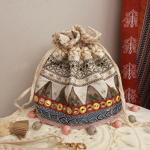 Bucket Handbag with Pom Pom Decoration