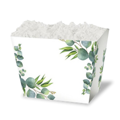 White gift box decorated with eucalyptus leaves in front of a black background