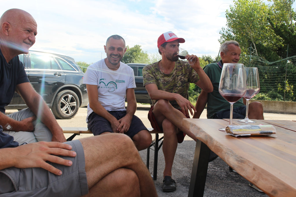 group of people drinking natural wine