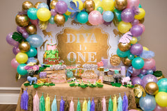 Pastel jungle themed 1st birthday at Village Walk - Lake Nona. Complete party planning: invitations, signage, cake table set-up, favors, photo booth, vendor contracting, entertainment contracting, custom balloons, decor, tableware.