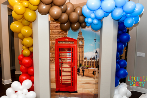 London themed photo backdrop and balloon arch