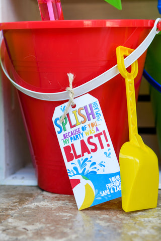 Beach bucket party favor for a boy birthday pool party
