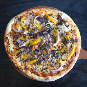 Bistone pizza, Wyoming bison sausage, yellow peppers, red onions, sage. Hand fired pizza from Pizzeria Caldera, Jackson, Wyoming