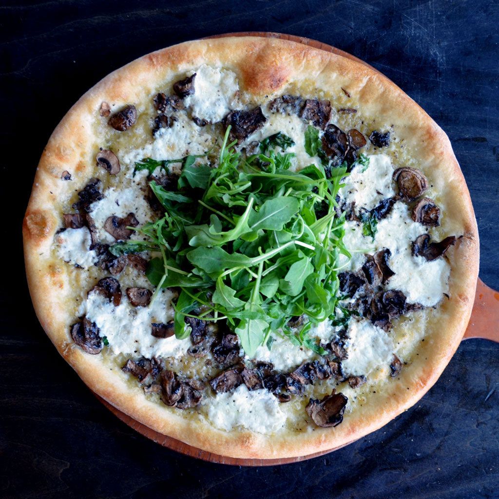 The Funghi - White sauce, fresh mozzarella, portobello and crimini mushrooms, truffle oil, cracked black pepper