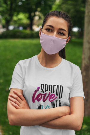 Woman in white t-shirt spreading pandemic awareness by wearing mask