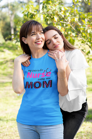 Woman in blue t-shirt smiling at her daughter