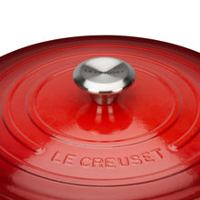 Load image into Gallery viewer, A close up of the pot lid with the le crueset logo embossed and the branded pot handle