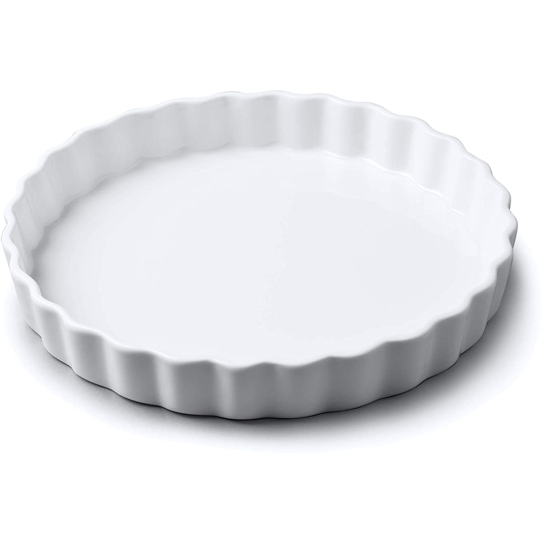 a medium white flan dish with crimped edges