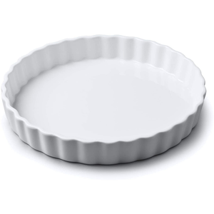 a large porcelain flan dish with crimped edges